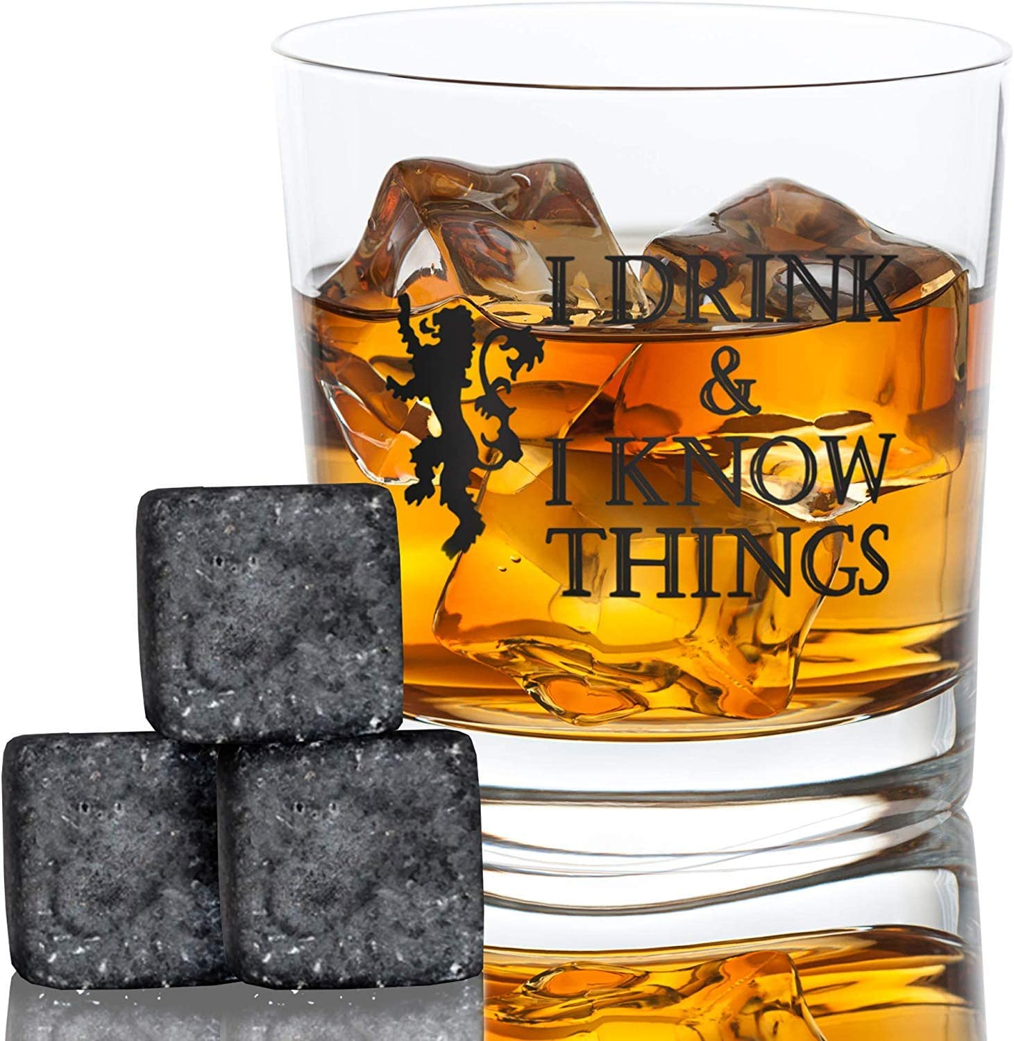 This is an image of a whiskey glass filled with whiskey and three chilling granite stones beside it.
