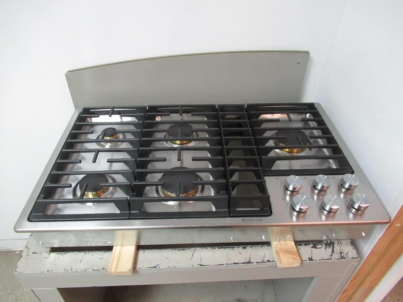 Jenn-Air 36 inch JX3 Stainless Steel Gas Cooktop With 310 CFM Down Draft JGD3536GS