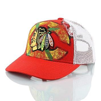 8662cf2ea3c Reebok Chicago Blackhawks Print Trucker NHL Cap  Amazon.co.uk  Sports    Outdoors