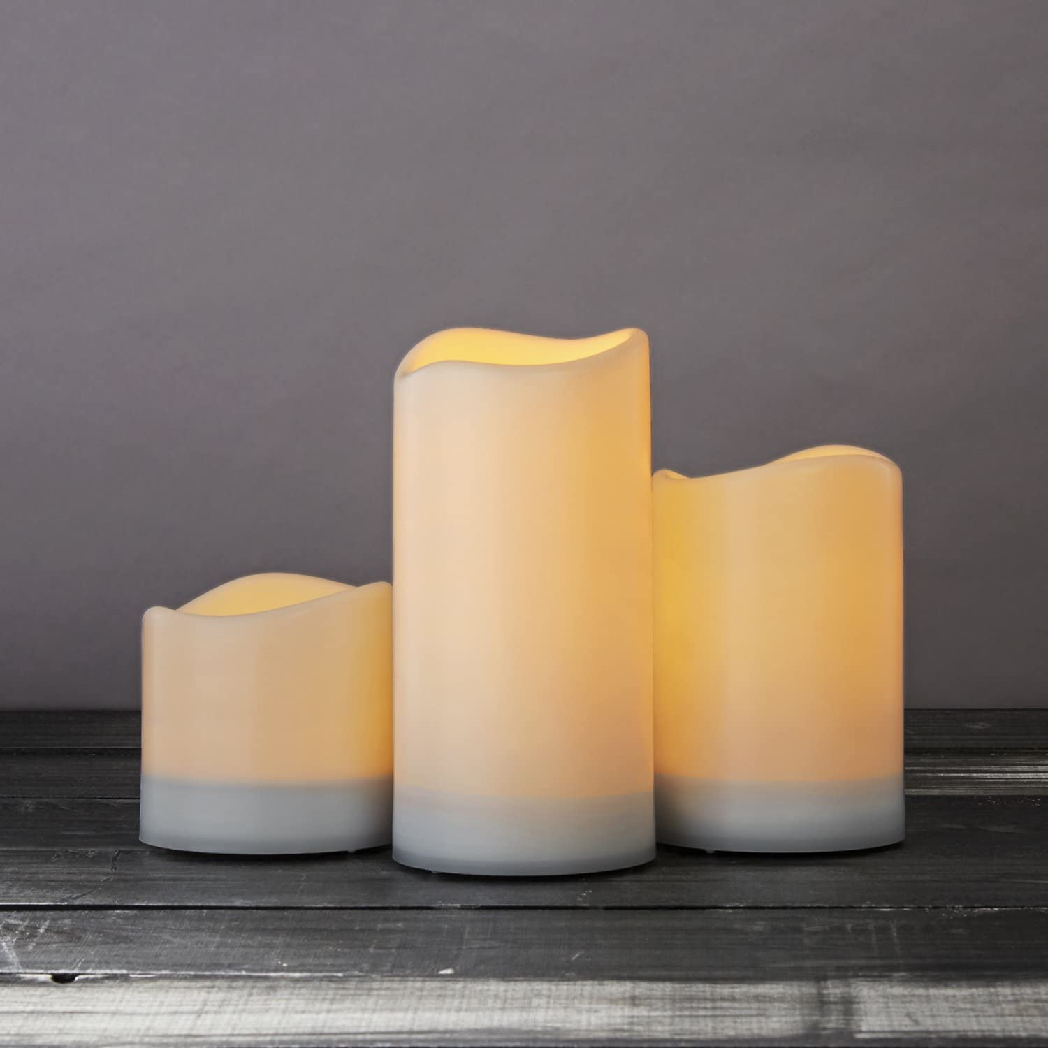 Outdoor Solar Powered Candles - Large LED Flameless Pillar, 4 Inch Diameter, Flickering Warm White Light, Dusk to Dawn Timer, Rechargeable Battery Included - Set of 3
