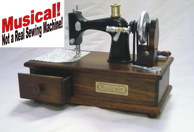 Musical – 4 ½ pulgada envejecido portátil máquina de coser de botones y lazos (tema # 171): Amazon.es: Hogar