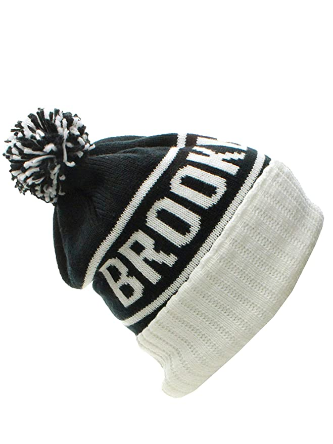 31abc8896b6 American Cities Brooklyn NY Champions Cuff Cable Knit Pom Pom Beanie Hat  Cap at Amazon Men s Clothing store