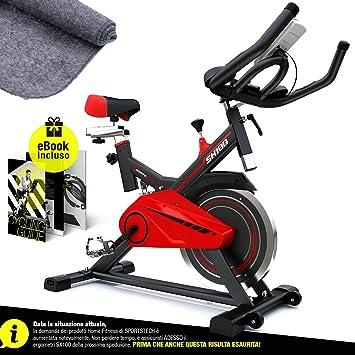 Sportstech - SX100 - Bicicleta estática profesional con volante de 14 kg, apoyabrazos acolchado, sillín cómodo con muelle