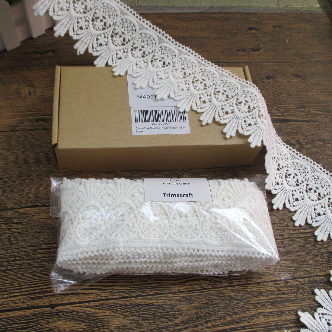 BEIGE EMBROIDERED TRIM ON NET LACE SOLD PER METRE 9CM/'S WIDE APPROX.