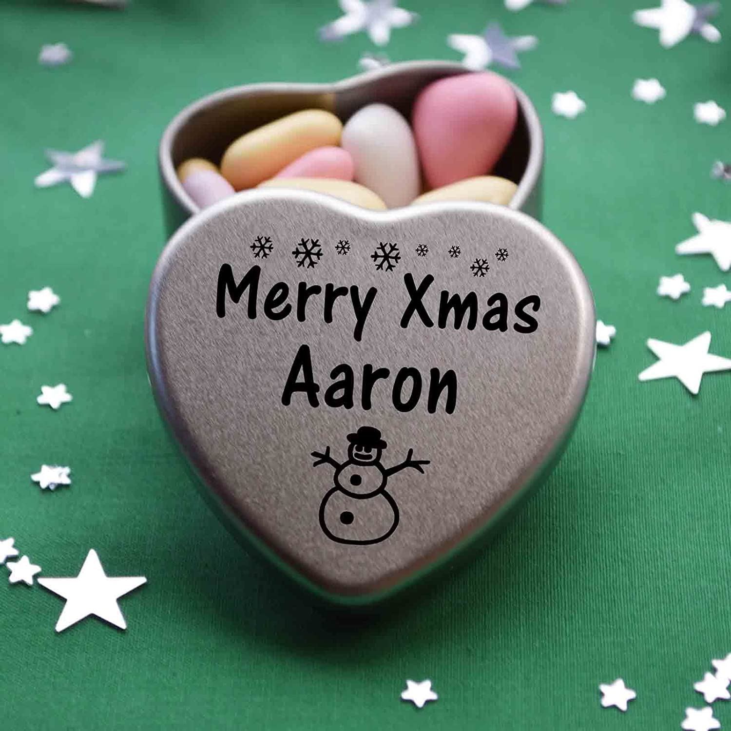 Merry Xmas Aaron Mini Heart Gift Tin with Chocolates Fits Beautifully in the palm of your hand. Great Christmas Present for Aaron Makes the perfect Stocking Filler or Card alternative. Tin Dimensions 45mmx45mmx20mm. Three designs Available, Father Christm