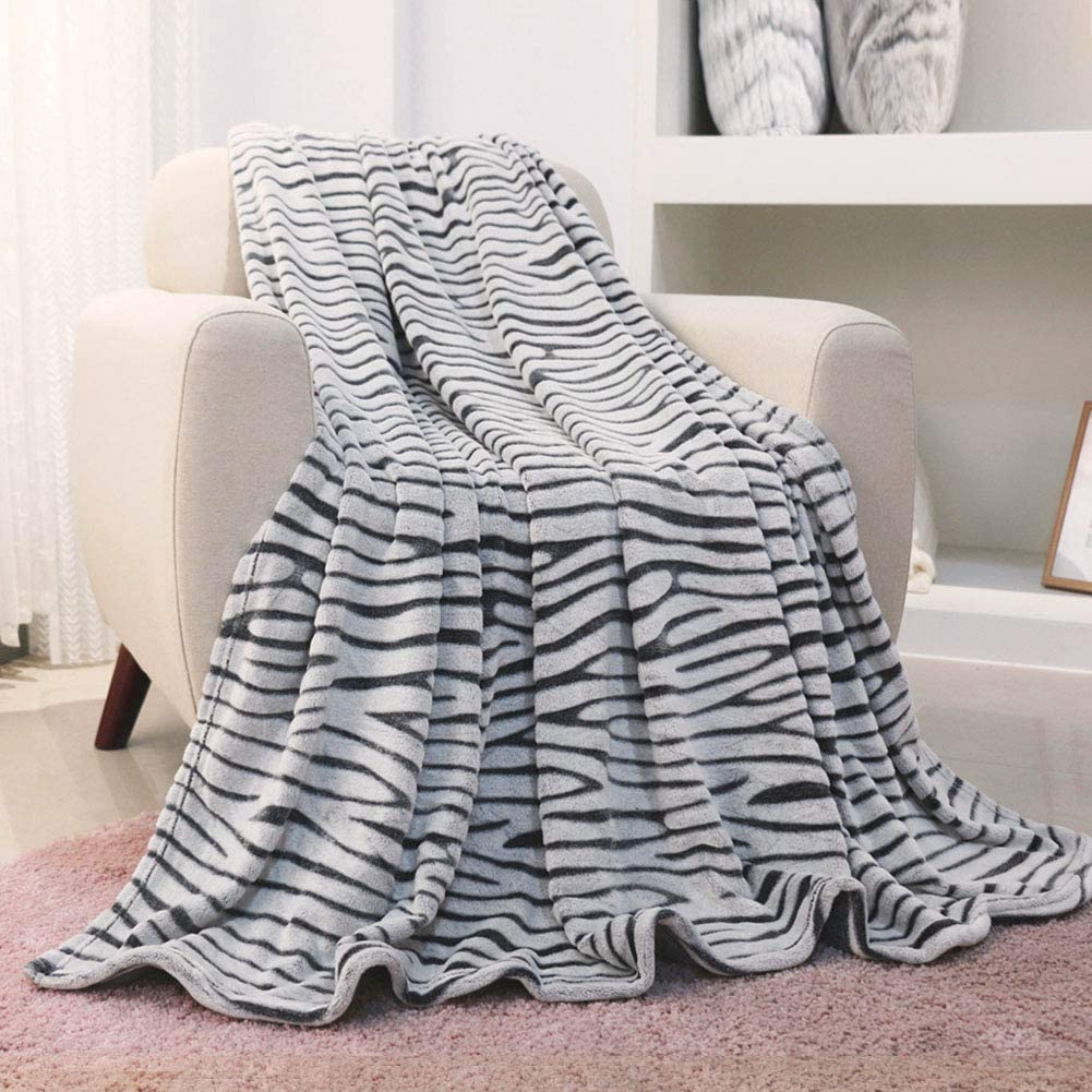 FY FIBER HOUSE Flannel Fleece Throw Microfiber Blanket with 3D Zebra Print,50 by 60-Inch,Black