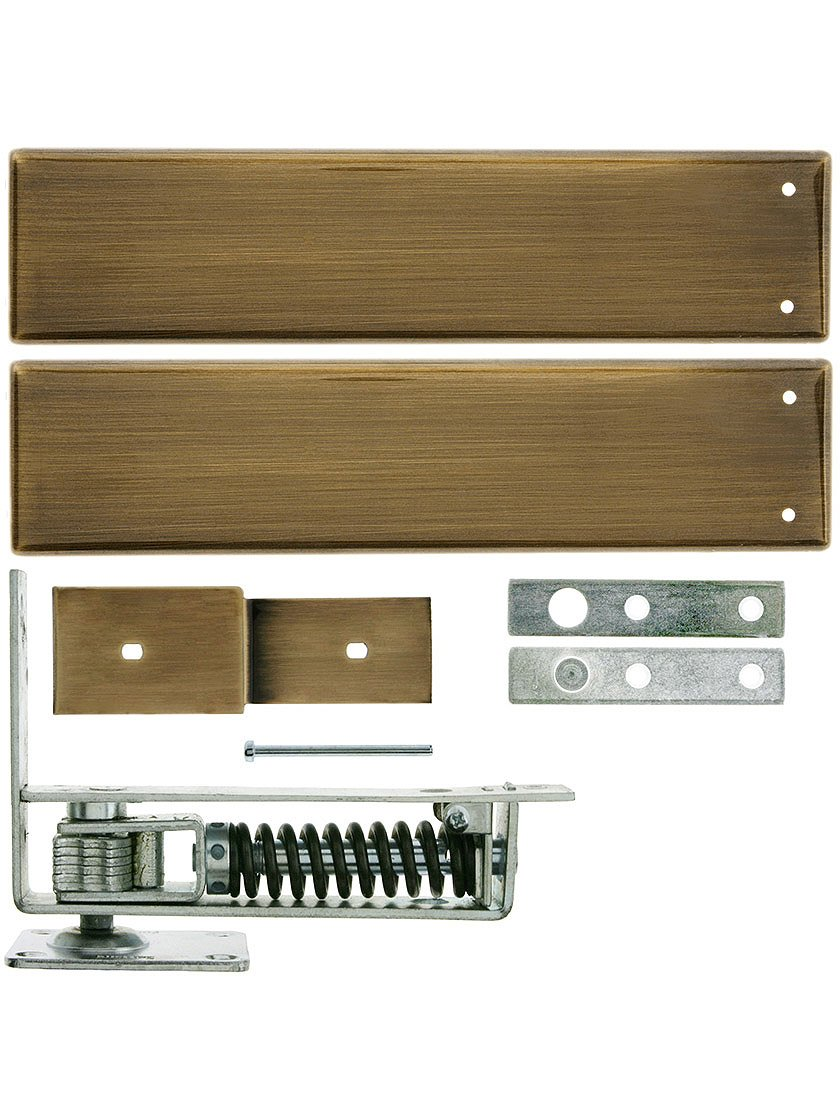 Standard Duty Swinging Door Floor Hinge With Plated Steel Cover Plates In Polished Brass Finish