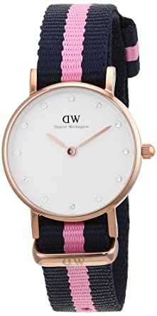 photos officielles 75f74 6c9aa Daniel Wellington - 0906DW - Classy Winchester - Montre Femme - Quartz  Analogique - Cadran Blanc - Bracelet Nylon Bleu / Rose