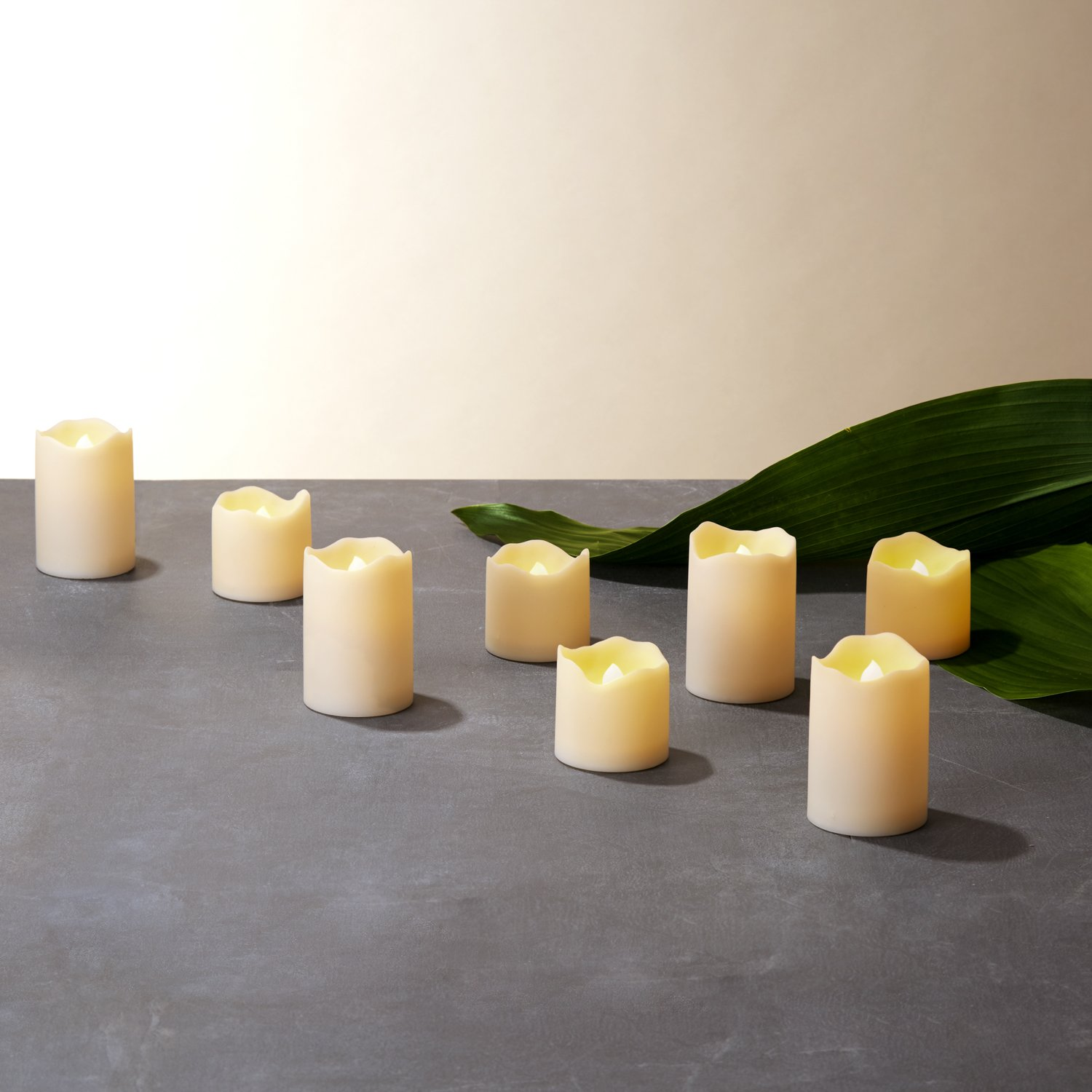 Outdoor Flameless Votive Candles, Warm White and Color Changing LEDs, Battery Operated, Water Resistant, Ivory Resin Candle Set, Batteries Included - 8 Pack