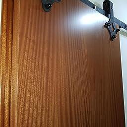 Yosoo Kit de puerta corrediza Polea de Rail suspendida sistema de puerta corredera conjunto completo para puertas interiores correderas tabiques granero armario Hardware de acero inoxidable, negro: Amazon.es: Bricolaje y herramientas