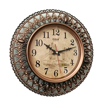 Buy Sonam Quartz Wall Clock 3597 ROUND Shaped COPPER and one