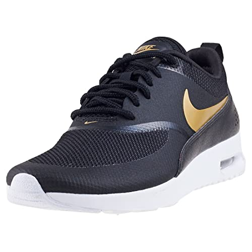 Wmns Air MAX Thea J, Zapatillas de Entrenamiento para Mujer, Multicolor (Black/Metallic Gold-White 002), 38.5 EU Nike