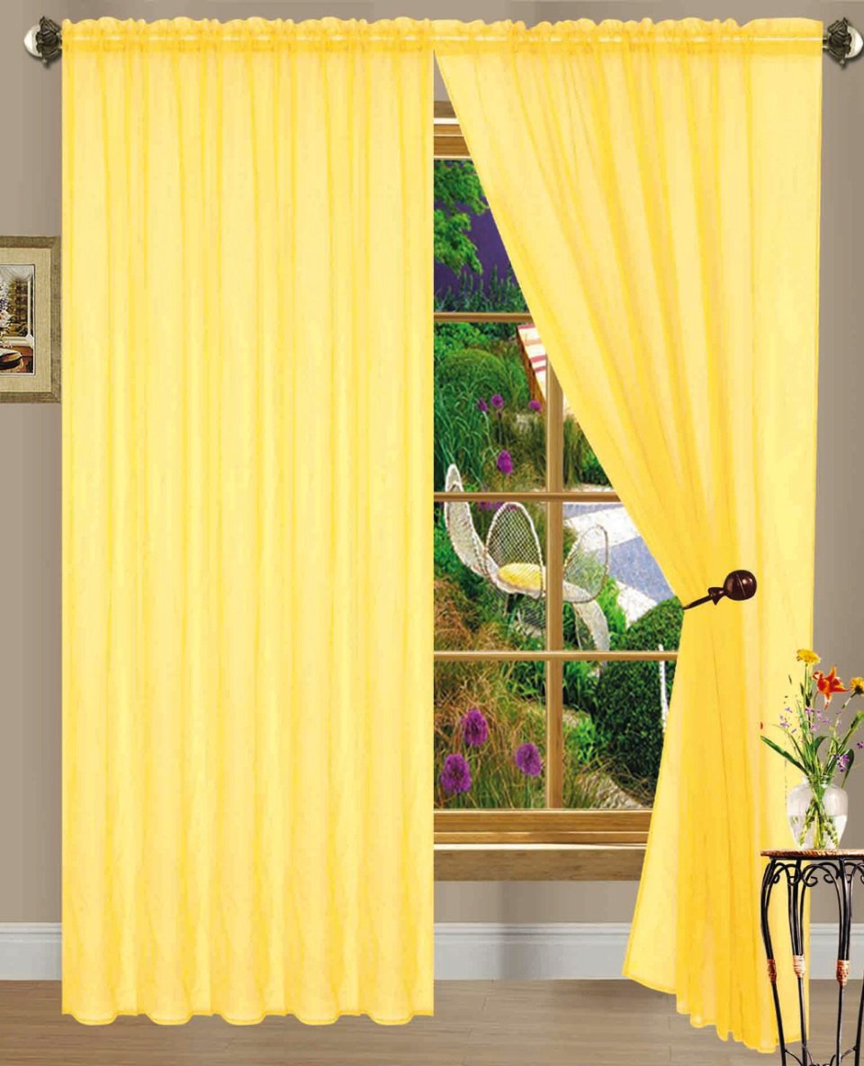 living stock lamp and drapes in yellow room knit oversize sofa with beige light blanket photo