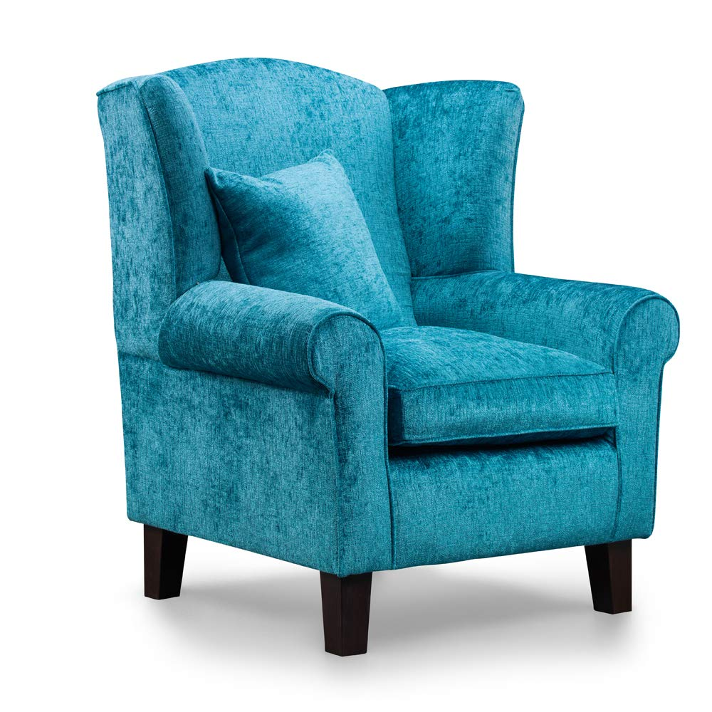 Sillón de color azul turquesa con alas para chimenea ...