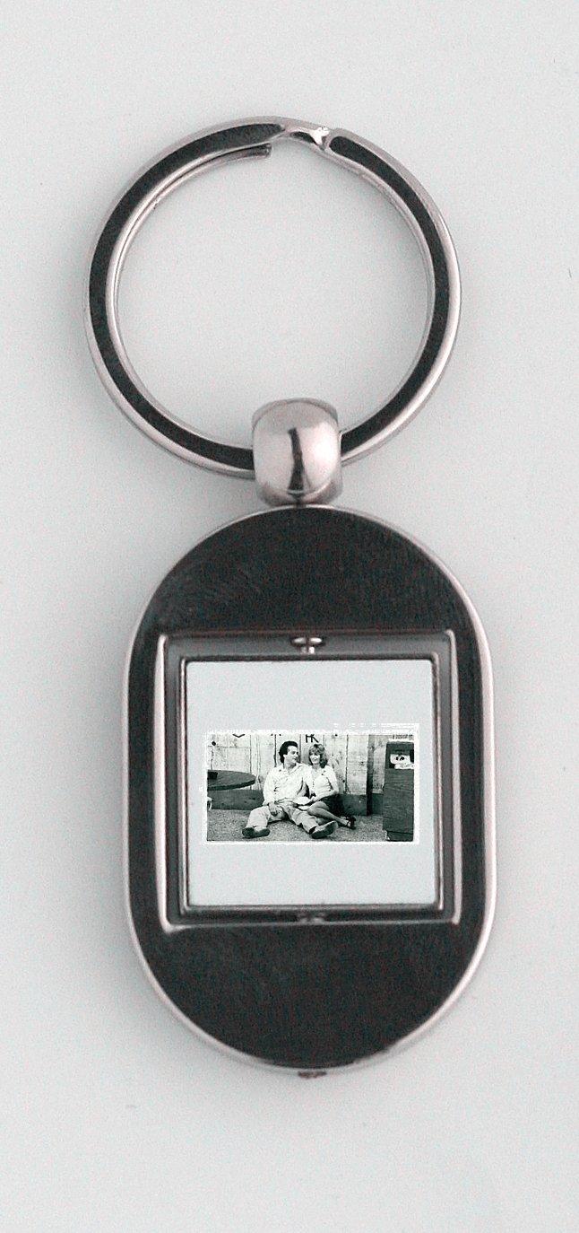 Penny Marshall y Jim Belushi llavero: Amazon.es: Hogar