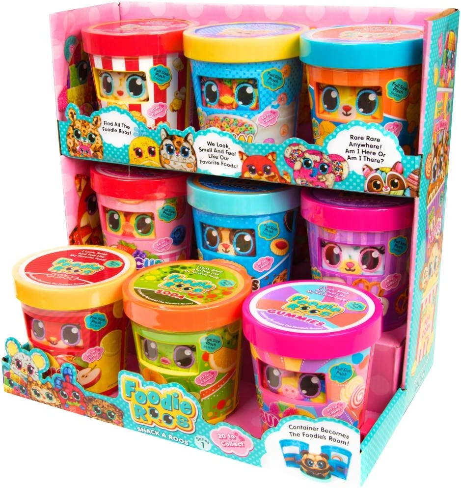 "Foodie Roos are the all-new adorable plush animals that look, smell and feel like the foods they love! They come in fun food containers with a cute ""Peek a Roo"" window so you can see what's inside! Collect all 20 including 2 hidden rares! MSRP: $9.99 USD Suggested Age: 5+ Availability: Available now at Target and Claire's"