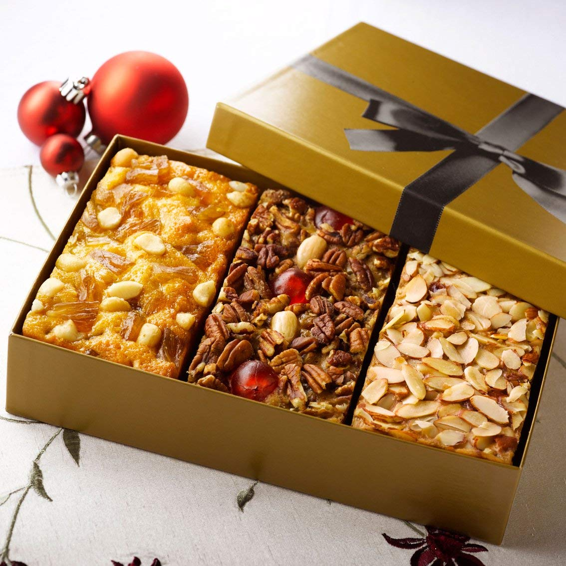 Grandma's Fruitcake Assortment Old Fashioned Traditional, Amaretto, Pineapple Macadamia Nut Flavors, 3-1 Pound Cakes in Gold Gift Box
