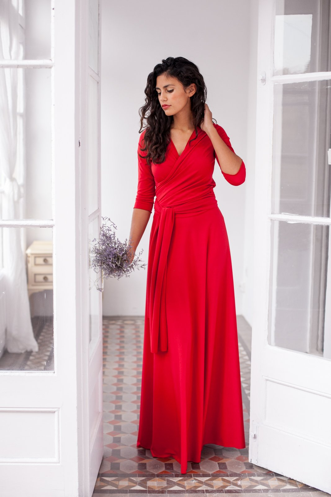 Long red multi way dress with sleeves, long red maxi dress, red convertible long sleeve dress, red waist tie dress, satin red infinity dress by Mimètik Bcn
