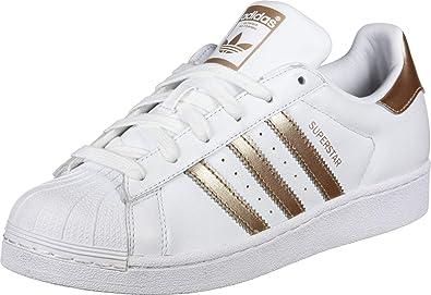 guión Elegancia Arashigaoka  Adidas Superstar Tenis para Mujer, Color Color Cloud White/Copper  Metallic/Core Black, Talla 2.5 Mex…: Amazon.com.mx: Ropa, Zapatos y  Accesorios