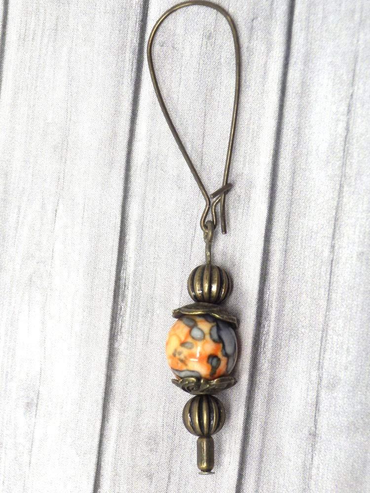 Vintage earrings in bronze and white jade tinted in orange and black