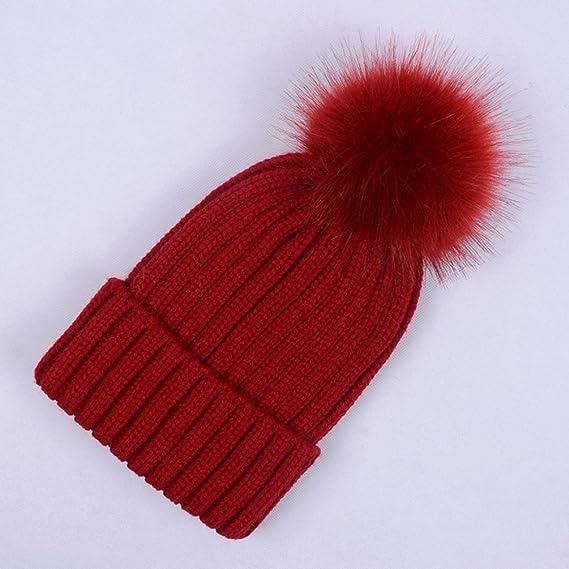 8b4e79cf7d1632 Lau's Women's Warm Ribbed Knit Winter Bobble Hat Faux Fur Pom Pom Beanie in  Navy: Amazon.co.uk: Clothing