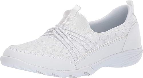 white slip on skechers