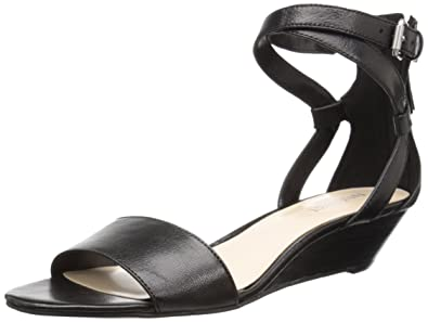 addf85103a Amazon.com | Nine West Women's Villian Leather Wedge Pump | Pumps
