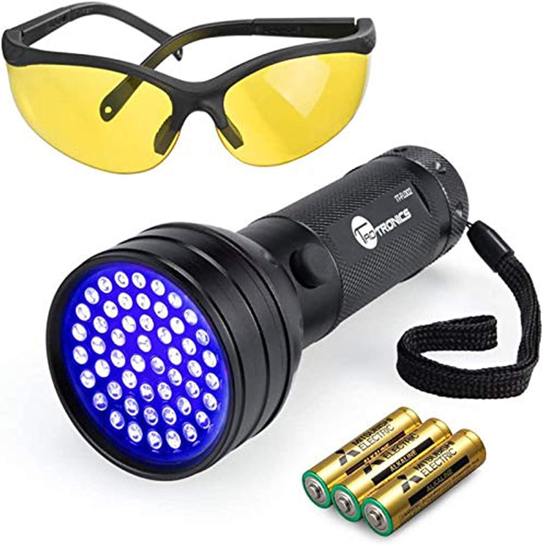 Taotronics 51 LEDs UV flashlight with sunglasses and 3 AAA batteries beside it.
