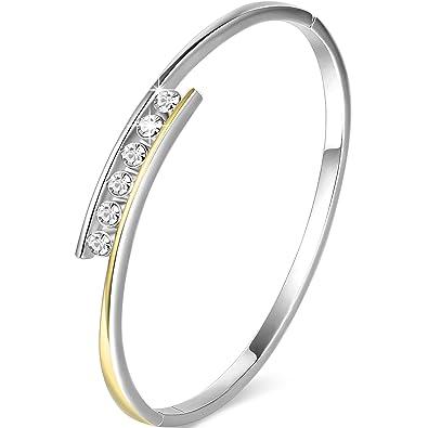 Bracelet plaqué or et argent avec six cristaux de Swarovski sur le dessus.