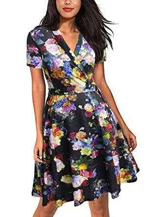 599dd47da8fe5 Lyrur Women's Office Midi Dress Short Sleeve Black Floral Skater Swing  Pockets (S,9023
