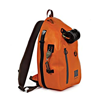 This best fishing sling pack photo shows the Fishpond Thunderhead Sling Pack in the orange color option.