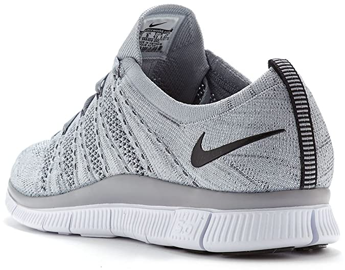 8bbf2ad9ff767 Nike Free Flyknit NSW Running Trainers in Wolf   Dark Grey   White 599459  002  UK 11 EU 46   Amazon.co.uk  Shoes   Bags