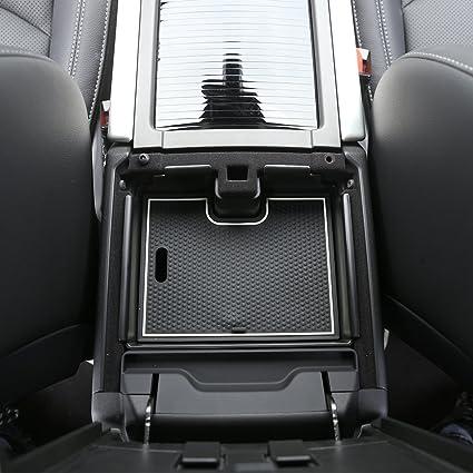 Bandeja de plástico negro organizadora de móviles para el reposabrazos del coche con alfombrilla antideslizante.