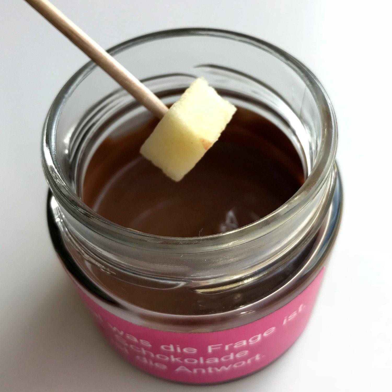 Chocolate fondue con leche 60g en un vaso con un refrán: