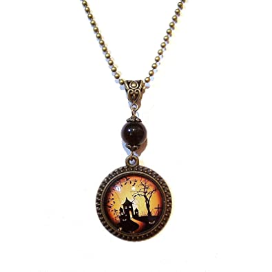 Amazon haunted house vintage cameo pendant w antique brass jewelry haunted house vintage cameo pendant w antique brass aloadofball