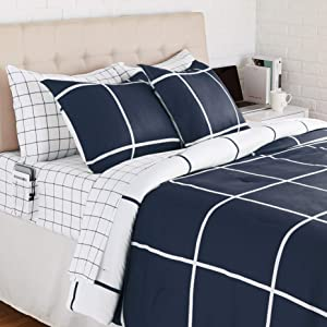 AmazonBasics Reversible Microfiber Bed-in-a-Bag with Elastic Storage Pockets - Full/Queen, Navy Grid