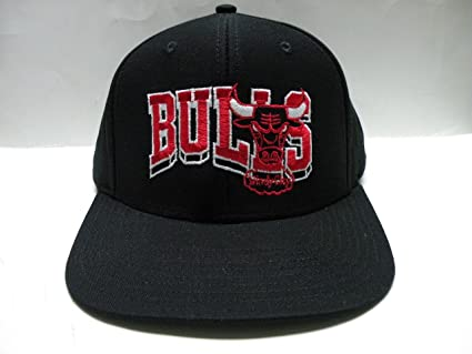 7efd1152172 Image Unavailable. Image not available for. Color  NBA Chicago Bulls Wave  All Black Retro Snapback Cap
