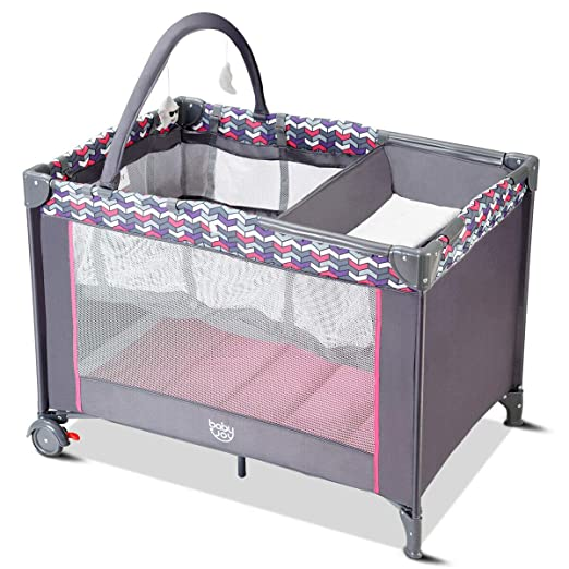 BABY JOY Portable Baby Playard, Removable Bassinet and Changer, Newborn Napper with Cute Toys, Wheels & Brake, Oxford Carry Bag