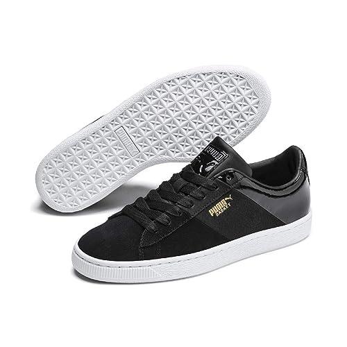 Schwarz weiße Sneakers mit weißem Stern und hinten gelb abgesetzt