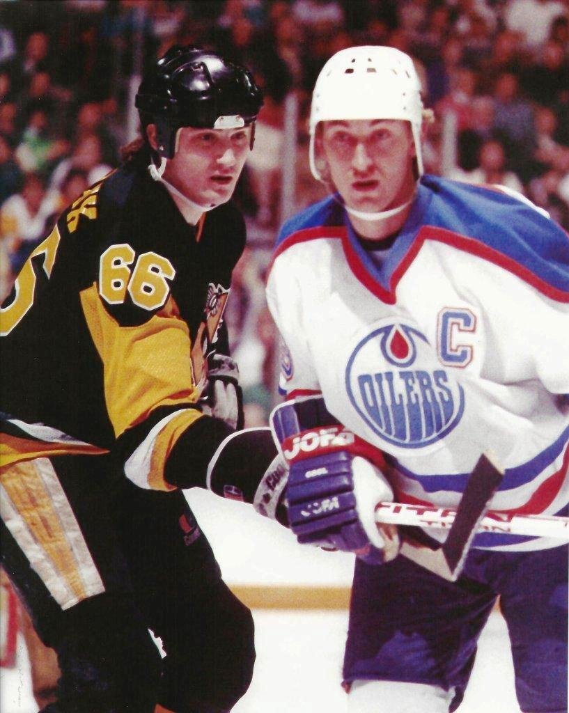 Hockey Wayne Gretzky & Mario Lemieux battling for a puck - 11''x14'' Photo, Mounted in 16''x20'' Double Matt and Framed with Plexi Glass by NHL Collectibles