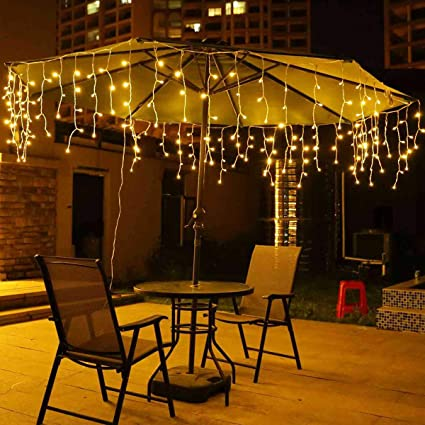 HUXICUI 10 Ft 96 Led Window Curtain Icicle String Lights for Wedding on christmas trees ideas, icicle photography, led christmas lights ideas, icicle christmas, string lights ideas,