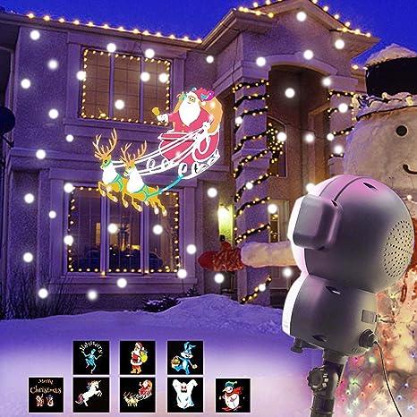 Proyector animado de nieve JEENSO para decoración de Halloween o Navidad, luces LED de proyección con función de reproducción de música y mando a ...