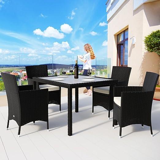 Deuba - Salon de Jardin - Ensemble 4+1 - Noir, polyrotin - 4 chaises  empilables + Table avec Plateau en Verre dépoli - Coussins Couleur crème  Compris ...