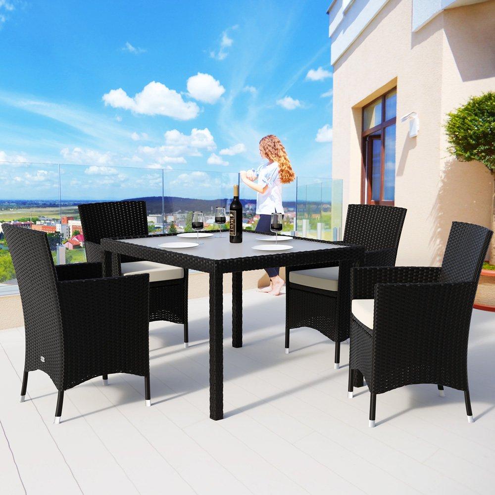 Deuba | Salon de Jardin - Ensemble 4+1 • Noir, polyrotin | 4 chaises  empilables + Table avec Plateau en Verre dépoli • Coussins Couleur crème  Compris ...