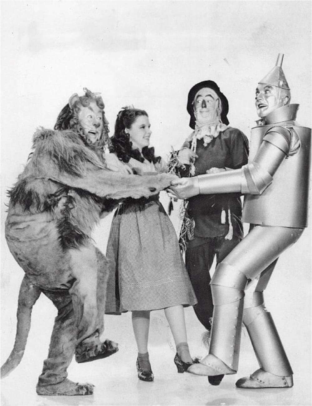 Laminated 24x31 inches Poster: The Wizard of Oz Bert LAHR Cowardly Lion Judy Garland Dorothy Ray Bolger Scarecrow Jack Haley Tinman Musical Fantasy Film Movie Motion Picture Cinema Courage