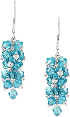 Silver angelfish charm dangle earrings adorned with cobalt blue and bright pink Czech glass beads.