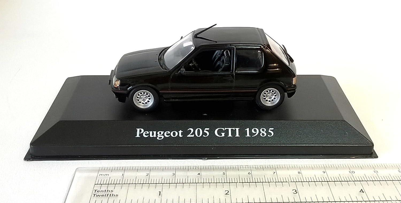 Générique Peugeot 205 GTI 1985 1:43 - Dominique CHAPATTE Cars - DIECAST Metal: Amazon.es: Juguetes y juegos