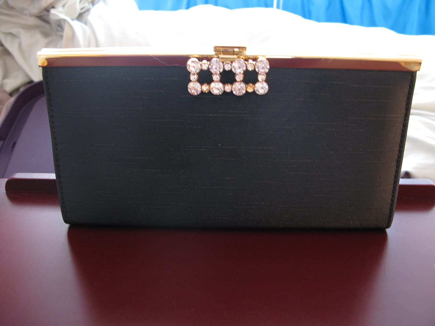 Black Purse with gold trim and-Rhinestone Closure
