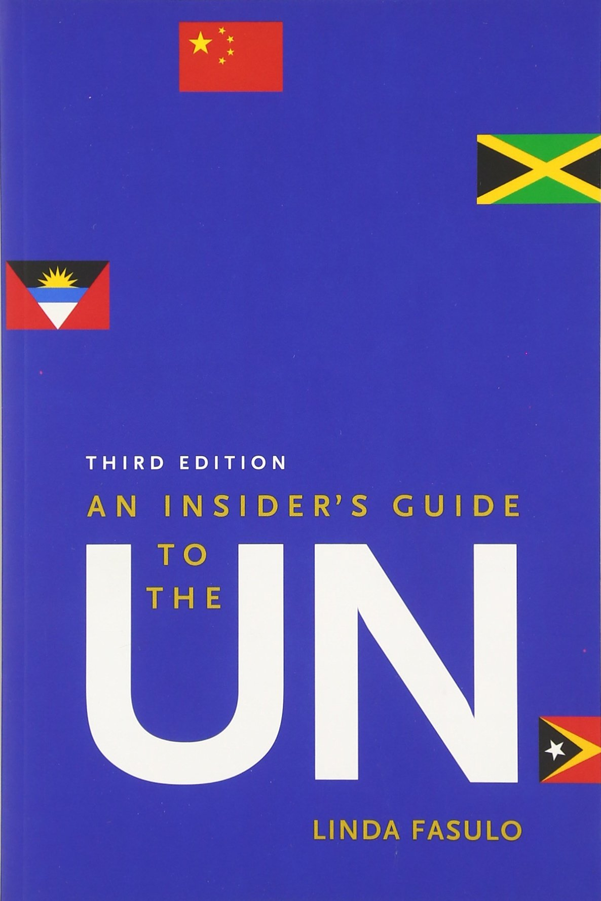 Book Cover - royal blue background featuring a handful of international flags; the letters UN are in bold white on the cover