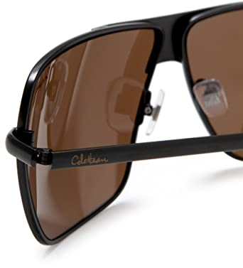 5edf7f075e2 Cole Haan Men's C704 Stamped Metal Sunglasses,Black Frame/Brown Lens,one  size: Amazon.co.uk: Clothing